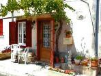 Maison de Vigne with south facing vine shaded terrace..