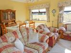 Spacious and comfortable sitting room with DVD player with a selection of CD's and books