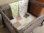 A new playpen and linens for a little one.