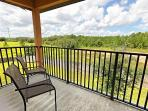 View from the balcony in the double-queen en-suite bedroom across beautiful wooded countryside