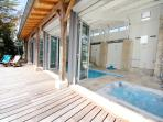 the heated indoor pool 4 x11 metres with hot tub fully opening to the sun deck