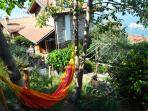 This photo shows the house, hammock, berceau/pergola and view over the lake including an island
