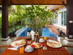 Breakfast in villa at outdoor pavilion beside swimming pool