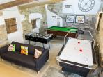 Games room with pool table, air hockey, table football, TV, DVD, CD player/Ipod docking station