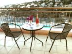 Cool off with a drink and enjoy beautiful views over hillside and sea from the main bedroom balcony