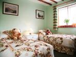 The twin bedroom overlooks a quiet country lane