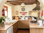 The open plan kitchen is well equipped