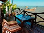 Relax on the private over-the-sea deck