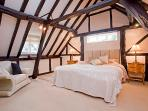 Spacious main bedroom in the Granary