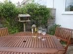 Relax with a glass of wine in the garden after walking the part of the Pembs coastal path.
