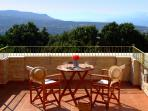 The veranda with marvelous view to the Cretan sea, the White Mountains and the sunset