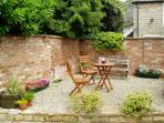 The sunny, walled patio area at the rear of the cottage