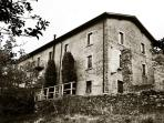 The beautiful stone 100 year old villa I Cinghiali nestled in the green hills of the Garfagnana