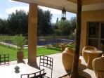 View from patio to swimming pool