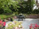 The terrace is a lovely area to sit and enjoy summer days and evening barbeques