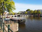 View from our windows Prinsengracht / Amstel with view on Magere Brug (skinny bridge) and Hermitage