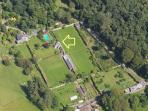 Aerial view of Pavilion Cottage and pool within walled garden. Shore and Orchard Cottage nearby.