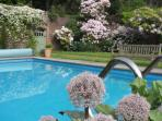 Coastal holiday cottage with pool by Rigg Bay within large beautiful walled garden.