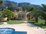 view from pool to villa Destino backdrop of beautiful Montgo mountain