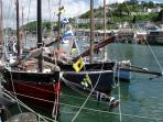 Taken at the Looe Luggar Festival, you can see The Little House tucked above the harbour