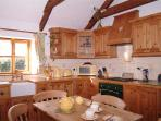 Fully equipped bespoke pine kitchen