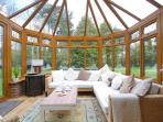Relax in the conservatory overlooking the lovely gardens