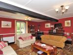 Large lounge with piano, card table and plenty of comfortable seating