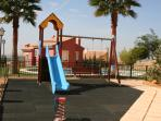 Childrens playground combined with the 1st community pool