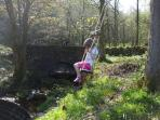 Swing next to stream and ancient packhorse bridge that adjoins the shared garden