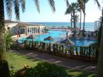 Communal Swimming Pool - Restaurant - Private Beach - Landscaped gardens