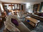 Plenty of comfy, spacious seating, beside the wood-burning stove
