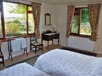 Twin bedroom.  Can accomodate third bed ( supplied).  Can be ensuite with shower room.