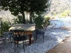 Shaded outside dinning area complete with stone topped table.