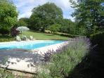 Secluded pool with views over fields and woods