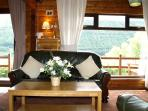 Rowan Lodge Front Room furnished with Green Leather Suite and complimented with Cream Soft Furnisihi