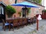 Outside patio area complete with quality garden furniture, seats 12, magnificent views, parking aval