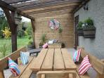 All year round alfresco dining under the terrace, very sheltered, (bbq provided).