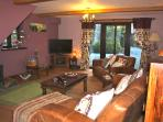 Large lounge area with log burner, plasma TV, DVD & CD player, board games, books  & small t