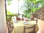 Alfresco dining on the vine-covered veranda with gorgeous sea view