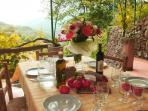 Alfresco dining with a view on the vine-covered veranda: details