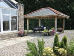 Outside Picnic Area, ideal bbqs next to the Cottage, great views across the countryside to the coast