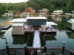 Folks, enjoy the new concrete dock with open 12' x 28' boat slip for your use.