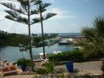 The fishing boats and harbour in Sissi. A coffee or beer can be enjoyed at the harbour side