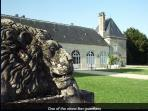 One of the ancient stone guardian lions & one of the 17th century buildings.