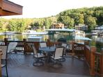 Enjoy dinners on your private deck with beautiful views of the water and surrounding trees.