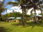 Another exterior photo. The Bamboo Cottage is on the right, and the Palms Cottage is on the left