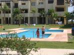 swimming pool. One of four communal pools available to guests.