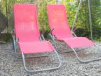 Sun loungers scattered around the garden