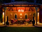 Moroccan theme garden lounge with comfy furniture Large table piped music, lovely and cool in summer