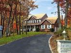 Post modern home nestled away in prestigious Red Cedar Creek
